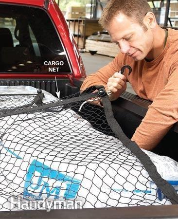 Utiliser un filet à bagages pour les chargements volumineux