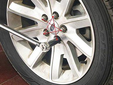 Serrer les écrous de roue de votre auto