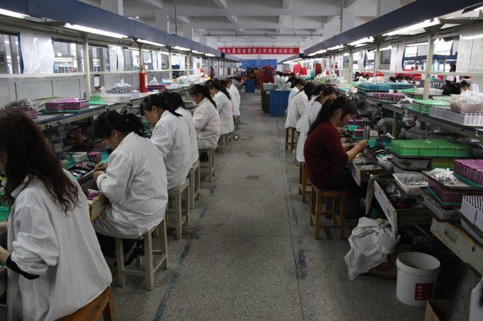 Employé de production dans l'industrie de  l'électronique en Chine chez Foxconn
