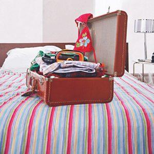 1. Mettre sa valise par terre pour la remplir.