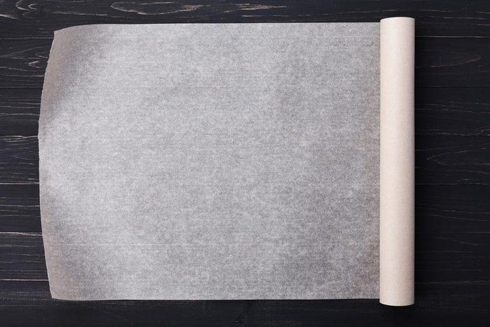 La papier paraffiné n'est pas adapté pour le four.