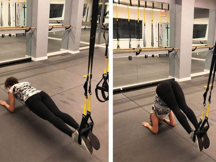 La planche vers position carpée est l'un des exercices TRX que vous devriez essayer.