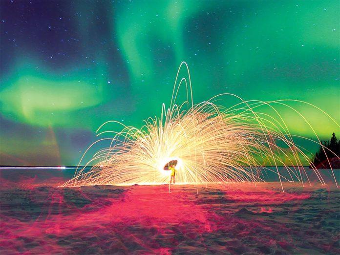 La beauté de l'hiver canadien à travers cette image d'aurores boréales.