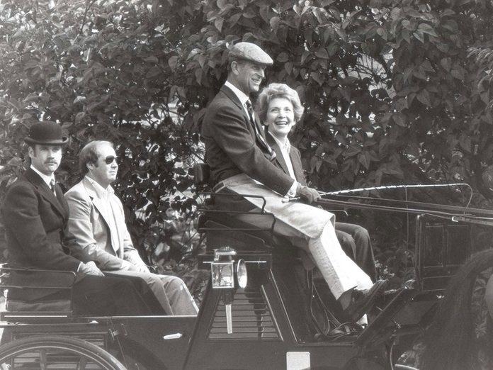 Le prince Philip lors d'une ballade avec la Première dame Nancy Reagan.